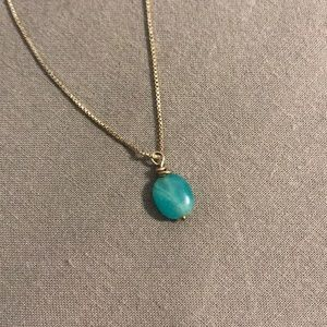 silver necklace with blue pendant